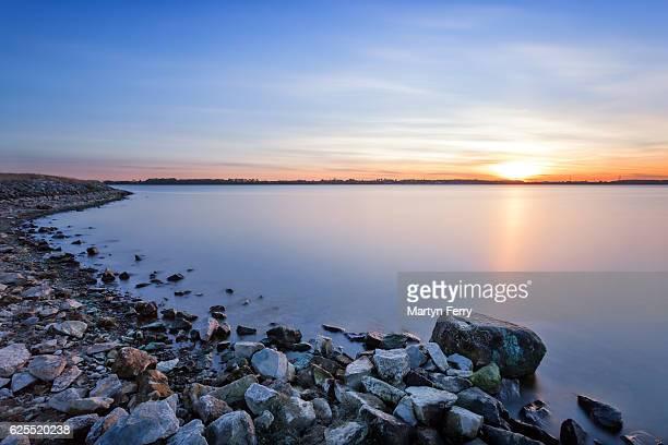 Sunset over tranquil lake at Grafham Water, Cambridgeshire, East Anglia, UK