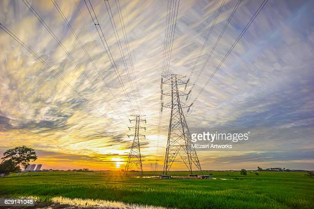 sunset over transmission tower pylone - creation stock pictures, royalty-free photos & images