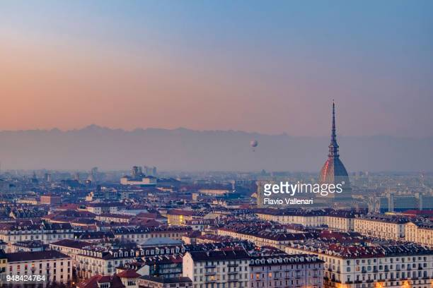 sunset over turin with the mole antonelliana in background. italy - torino foto e immagini stock