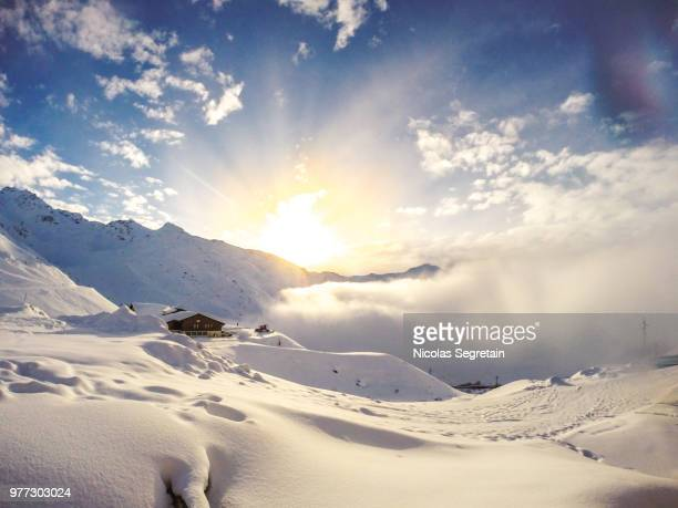 sunset over val thorens, savoie, france - val thorens stock pictures, royalty-free photos & images