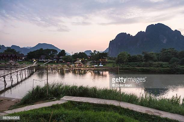 sunset over vang vieng - didier marti stock photos and pictures