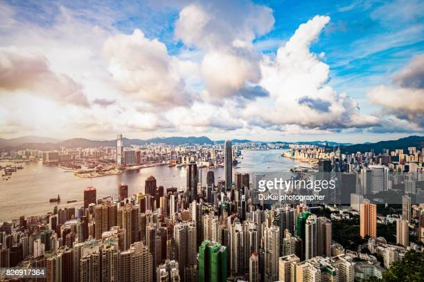 sunset over victoria harbor - hong kong stock pictures, royalty-free photos & images
