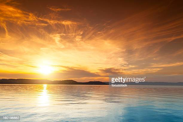 sunset over water - lake stock pictures, royalty-free photos & images