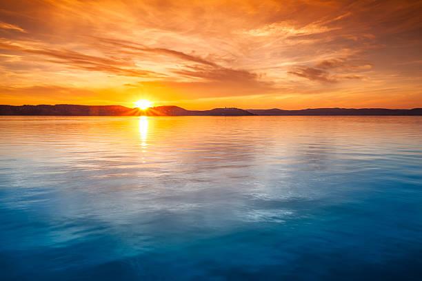 Sunset Over Water Wall Art
