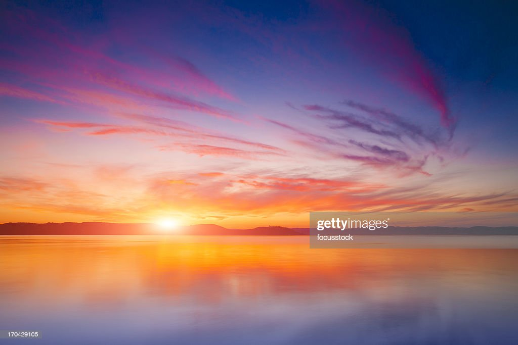 Sunset over water : Stock Photo