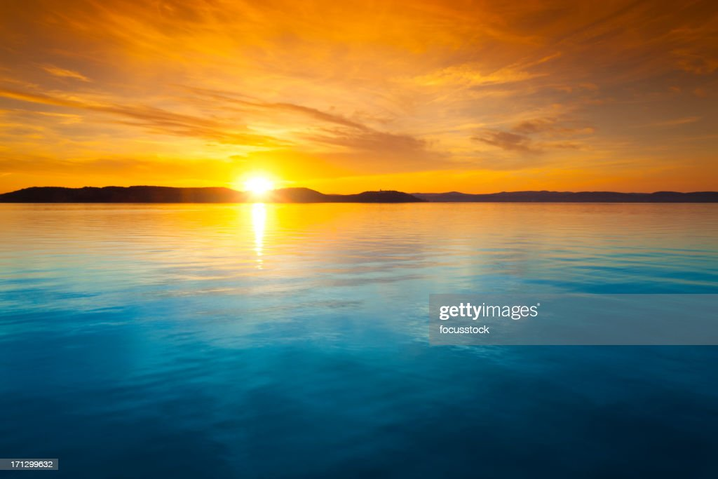 Sunset Over Water Stock Photo Getty Images