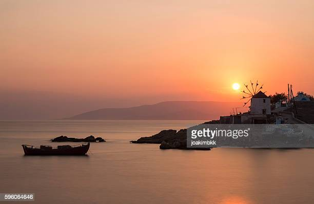 Sunset over windmill in Cyclades island of Greece