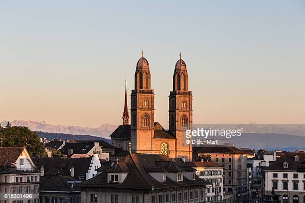 sunset over zurich cathedral - zurich stock pictures, royalty-free photos & images