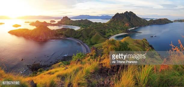 sunset, padar island, komodo national park, flores. - komodo island stock photos and pictures