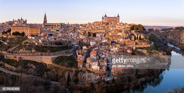 sunset, panorama, alcázar de toledo, toledo, spain - seville stock pictures, royalty-free photos & images
