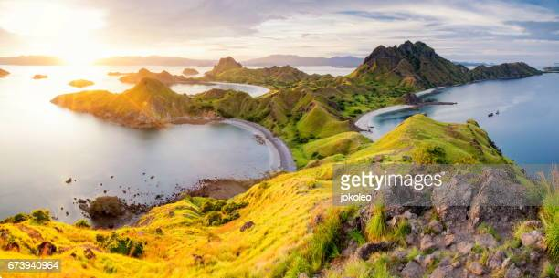 sunset panorama of padar island, komodo national park, indonesia - waimea bay hawaii stock photos and pictures