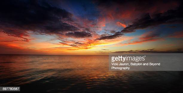 sunset panorama over fort myers beach, florida - lee county florida stock photos and pictures