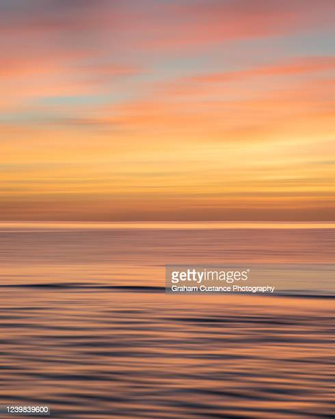 sunset - totland bay stock pictures, royalty-free photos & images