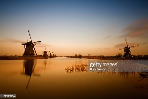 sunset - traditional windmill stock photos and pictures