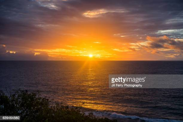 sunset - niue island stock photos and pictures