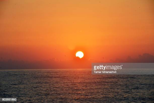 sunset - sunset beach stock photos and pictures