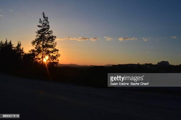 sunset - salah stock photos and pictures
