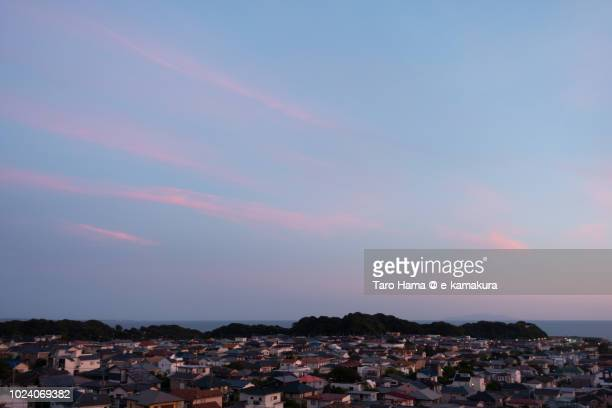 Sunset red clouds on Shichirigahama town in Kamakura city by Sagami Bay in Japan