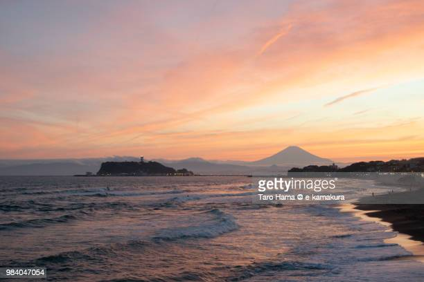 Sunset red-colored clouds on Mt. Fuji, Northern Pacific Ocean and Enoshima Island in Japan