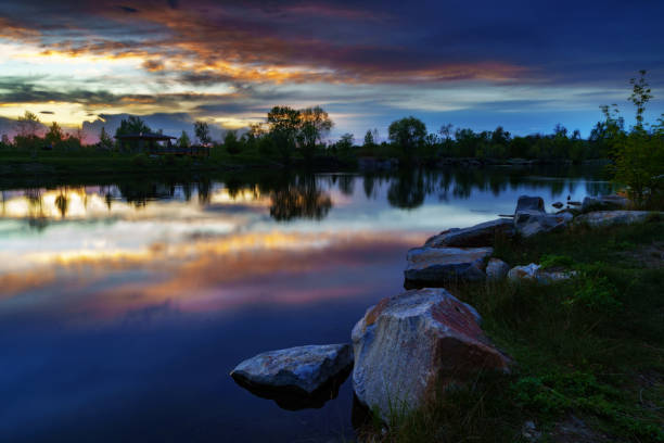 Sunset reflected in pond at Esther Simplot Park in Boise, Idaho, spring evening