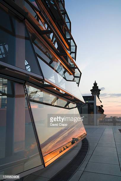 Sunset reflected in the glass panels of the Reichstag dome atop of the German Parliament Building, Berlin, Germany