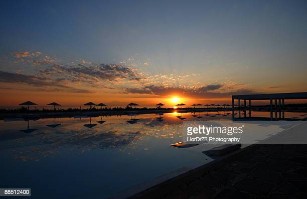 sunset reflected on sea  - belek stock pictures, royalty-free photos & images