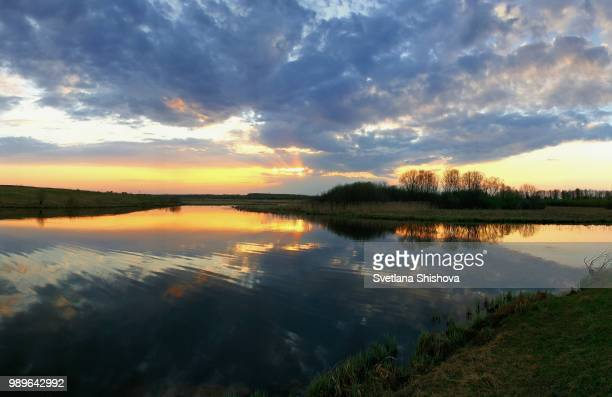 sunset reflected - svetlana stock photos and pictures