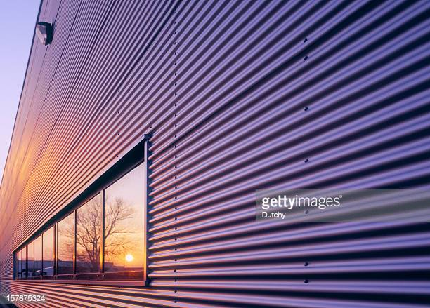 Sunset reflecting in window of warehouse.