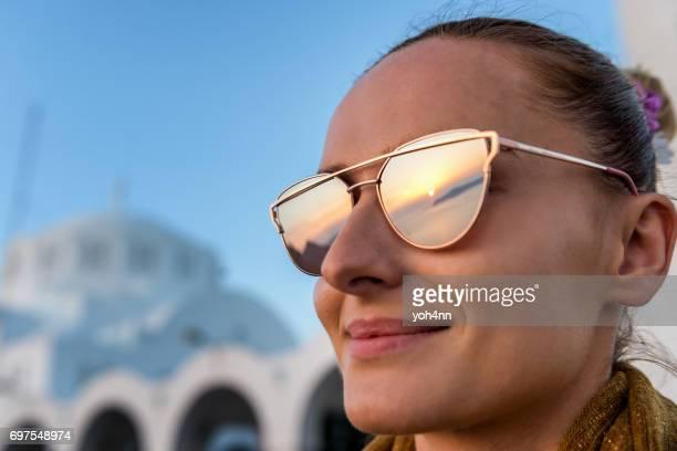 Sunset reflection in sunglasses in Santorini