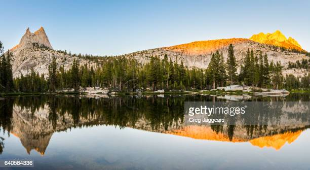 sunset reflection of cathedral peak, yosemite national park - john muir trail stock photos and pictures