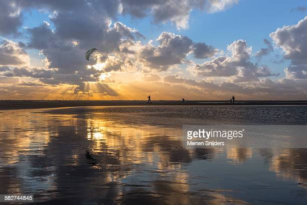 Sunset reflection on wet sand surface
