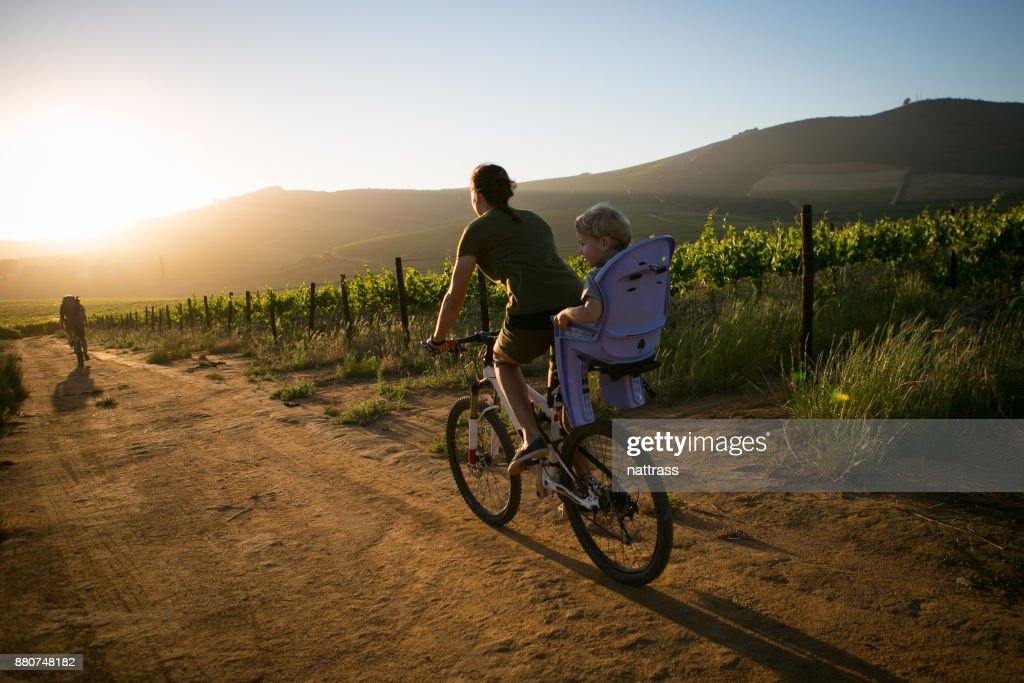 Sunset ride with the kids : Stock Photo