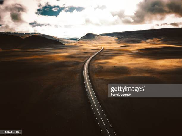 sunset road in iceland - dramatic landscape stock pictures, royalty-free photos & images