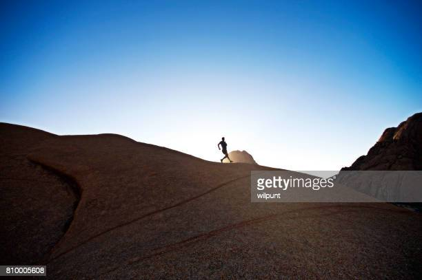 sunset rock trail runner - ridge stock pictures, royalty-free photos & images