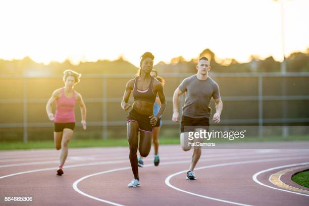 sunset run - sports round stock pictures, royalty-free photos & images