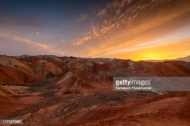 sunset scene of amazing landscape at geological park rainbow mountain, danxia landform, gansu province, zhangye, china - 張掖市 ストックフォトと画像