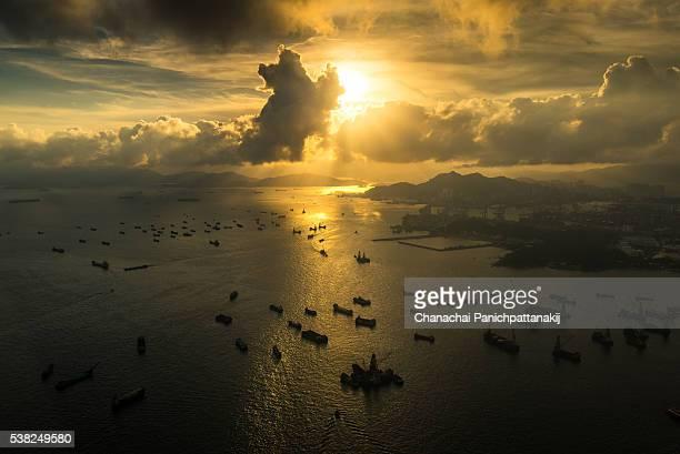 Sunset scene of cargo ships along the bay of Hong Kong