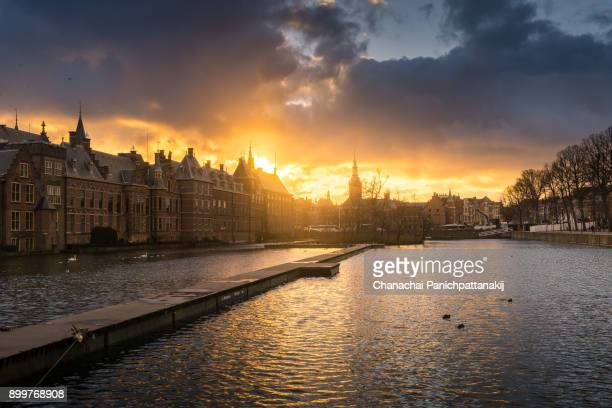 sunset scene of old town district in central area of the hague, netherlands - the hague stock photos and pictures