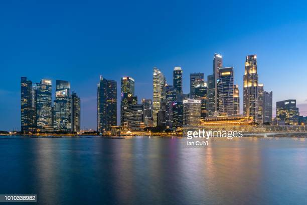 sunset scene of singapore city skyline (dusk) - singapore city stock pictures, royalty-free photos & images