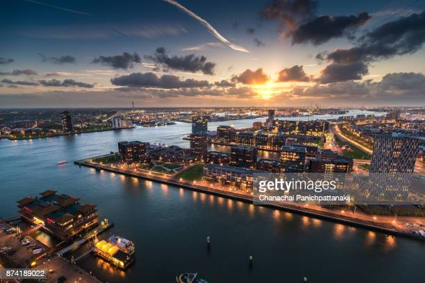 sunset scene over rotterdam city, netherlands - netherlands stock pictures, royalty-free photos & images