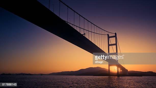 Sunset scenery of Tsing Ma Bridge with sunlight