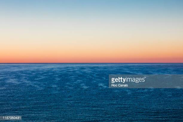 sunset sea - clear sky stock pictures, royalty-free photos & images