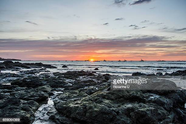 Sunset seascape and rocks, Tamarindo beach, Guanacaste, Costa Rica