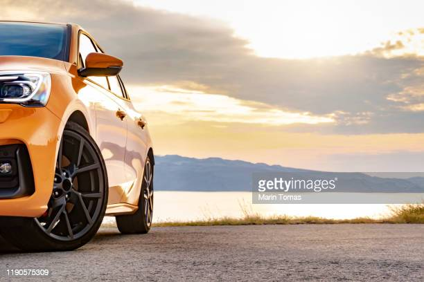 sunset seashore drive - land vehicle stock pictures, royalty-free photos & images