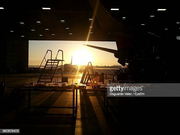Sunset Seen Through Airplane Hangar Against Clear Sky