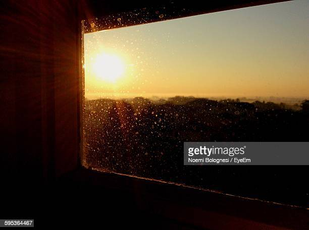 sunset seen through window - noemi foto e immagini stock