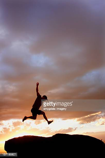 sunset silhouette man jumping