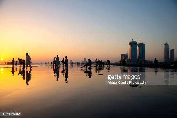 sunset silhouette - pakistan stock pictures, royalty-free photos & images