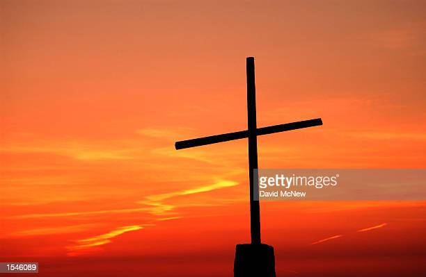 Sunset silhouettes a cross on top of Salvation Mountain May 30 2002 near Niland CA east of the Salton Sea 70yearold Leonard Knight has been painting...