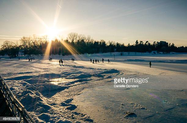 """sunset skaters on the rideau canal - """"danielle donders"""" stock pictures, royalty-free photos & images"""